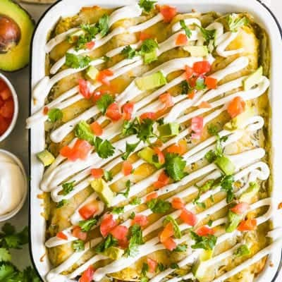 This HEALTHY CHICKEN ENCHILADAS Recipe(Chicken & Sweet Potato Enchiladas) are a healthy and delicious way to enjoy Mexican night! We love these tasty sweet potato black bean enchiladas and make them on the regular. This Skinny Chicken and Sweet Potato recipe is filled with vegetables and all kinds of good stuff. They are definitely a new favorite!