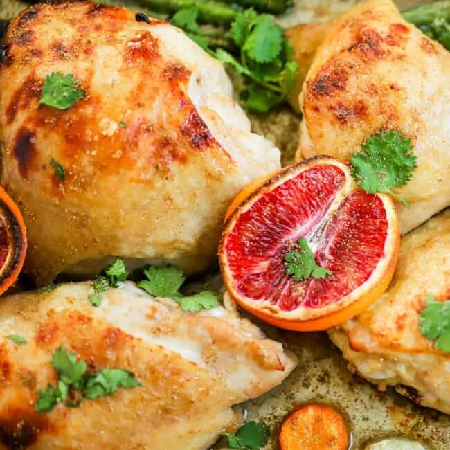 This Blood Orange Chicken Thighs Recipe is easy, flavorful, and delicious! Everyone loves an easy sheet pan meal! These Sheet Pan Orange Honey Chicken Thighs are the perfect weeknight dinner! Sheet Pan Chicken Thighs for the win.