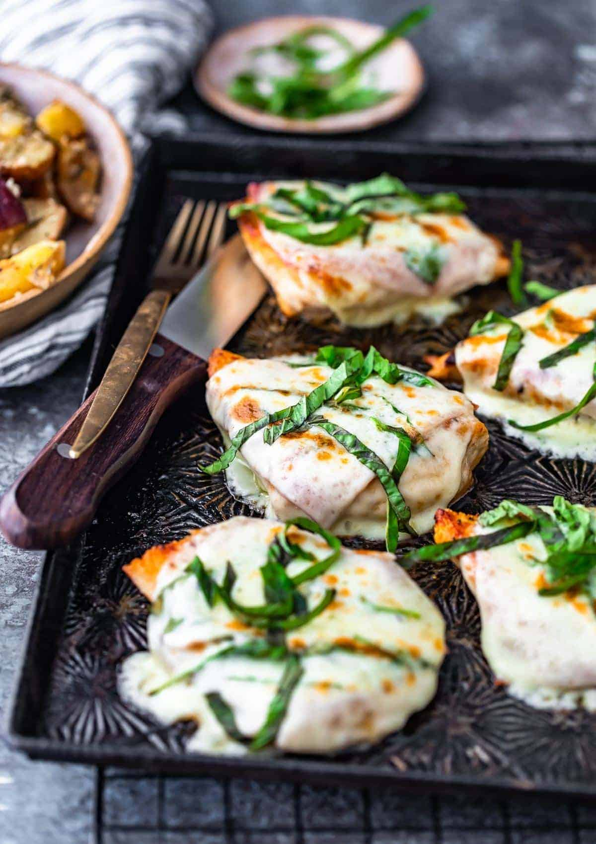 Cheesy Chicken with prosciutto and provolone on sheet pan