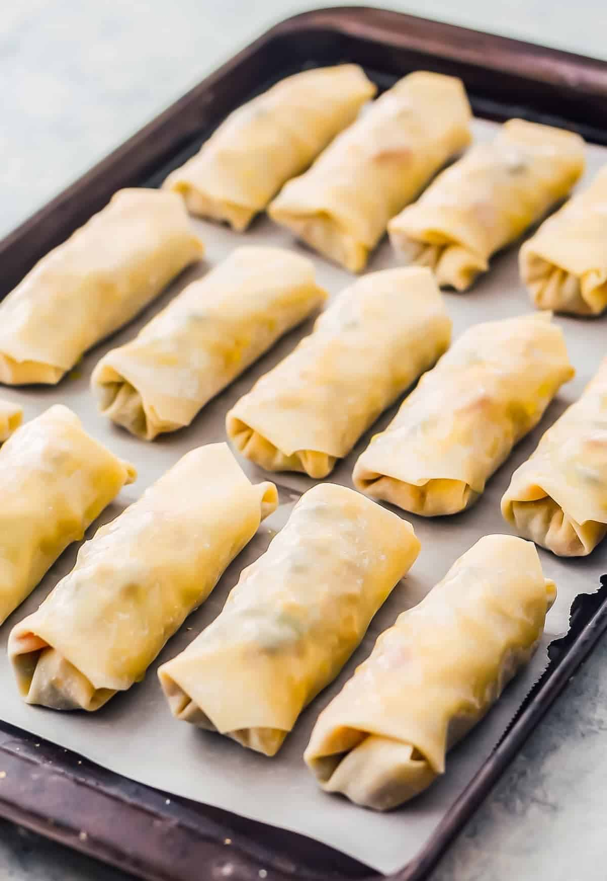 Baked Southwest Chicken Egg Rolls are packed with seasoned chicken and veggies, then baked until crispy and golden brown. Southwest Egg Rolls are served with an avocado dipping sauce, which is easy and perfect! This Baked Egg Rolls Recipes makes an outstanding appetizer to feed a crowd or a healthy after school snack!