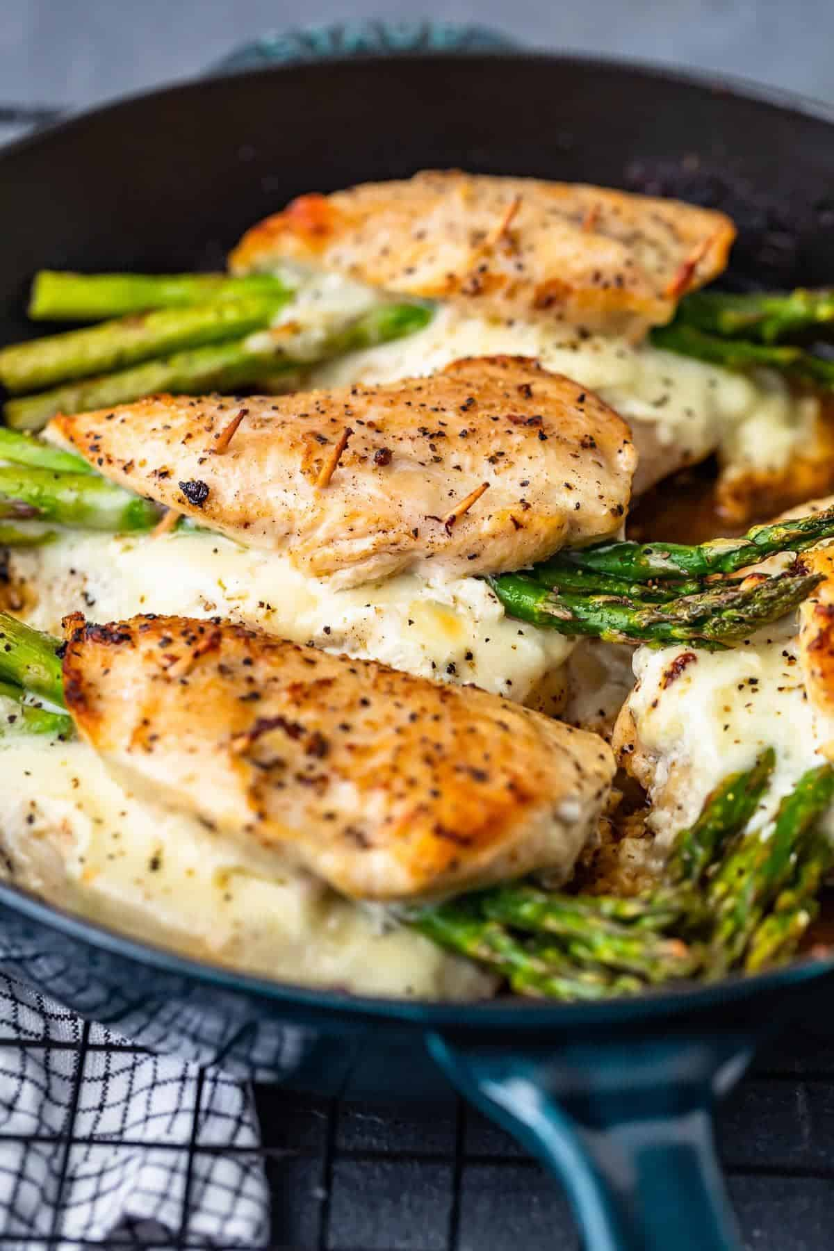 Cheesy Asparagus Stuffed Chicken side view in skillet