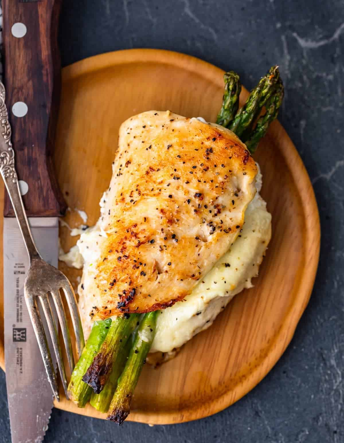 Cheesy Asparagus Stuffed Chicken Breast on a plate