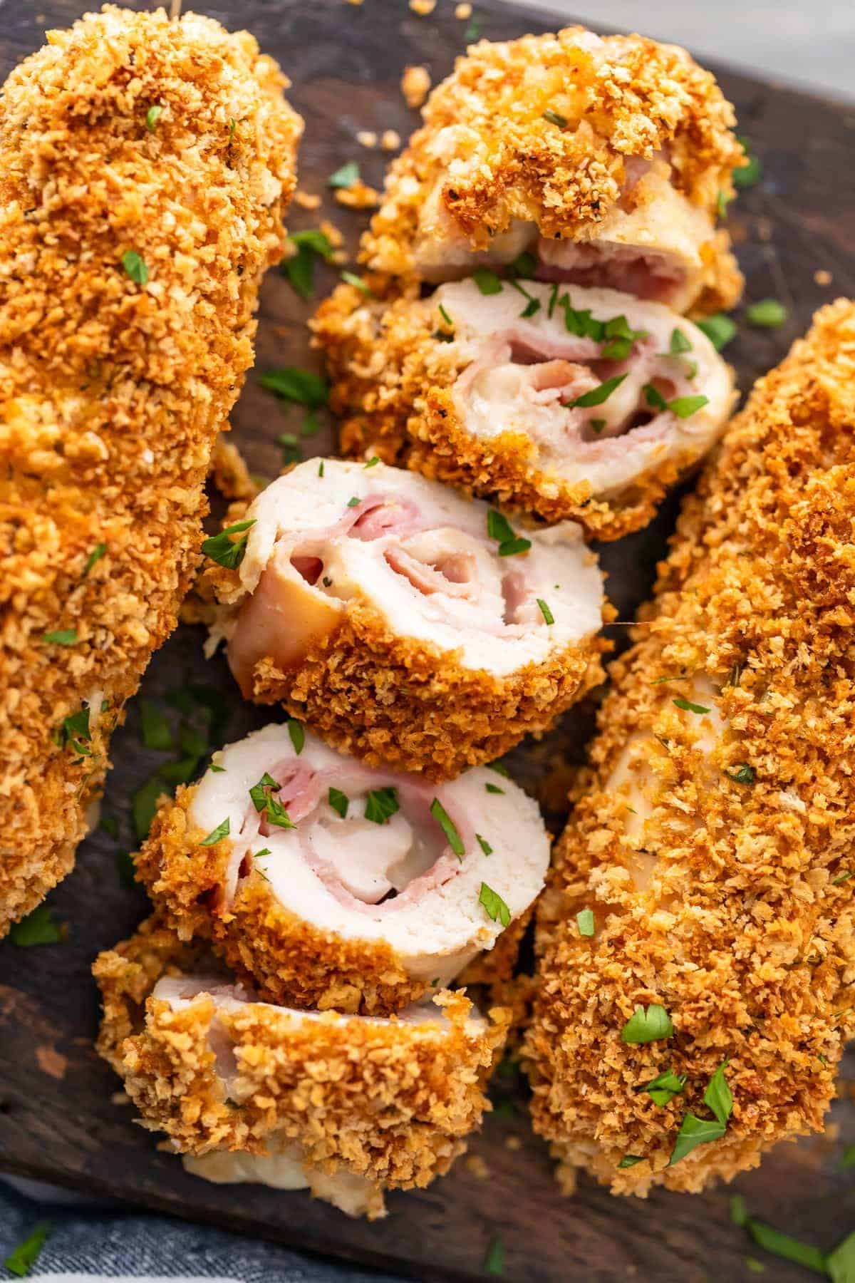 Baked Chicken Cordon Bleu is a delicious and healthy take on a classic chicken recipe. Layers of tender chicken, cheese, ham, and dijon sauce make this easy chicken recipe epic and a total mainstay.