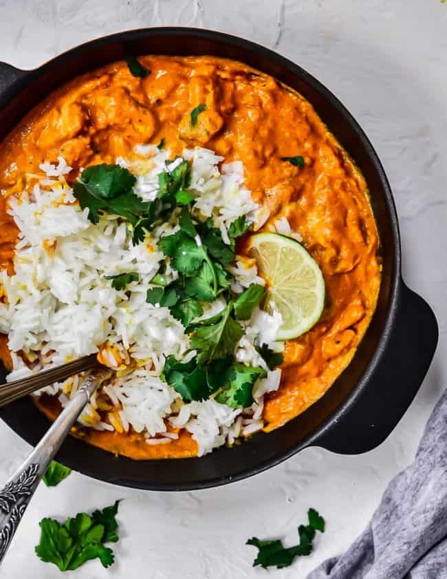 Chicken tikka masala is one of the most popular Indian dishes, and for good reason. How can anyone not love this explosion of spices, paired with the creamy texture of the sauce that the dish traditionally has. In this Easy Chicken Tikka Masala Recipe the chicken is made extra tender and buttery with a hint of freshness from the coriander and lime.