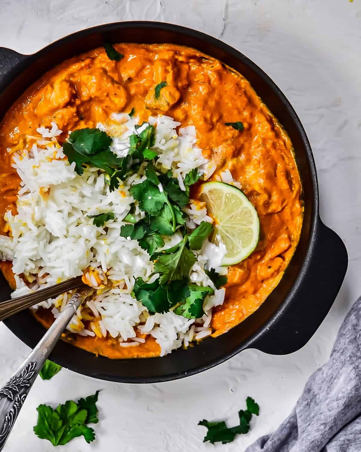 Chicken tikka masala with rice in skillet