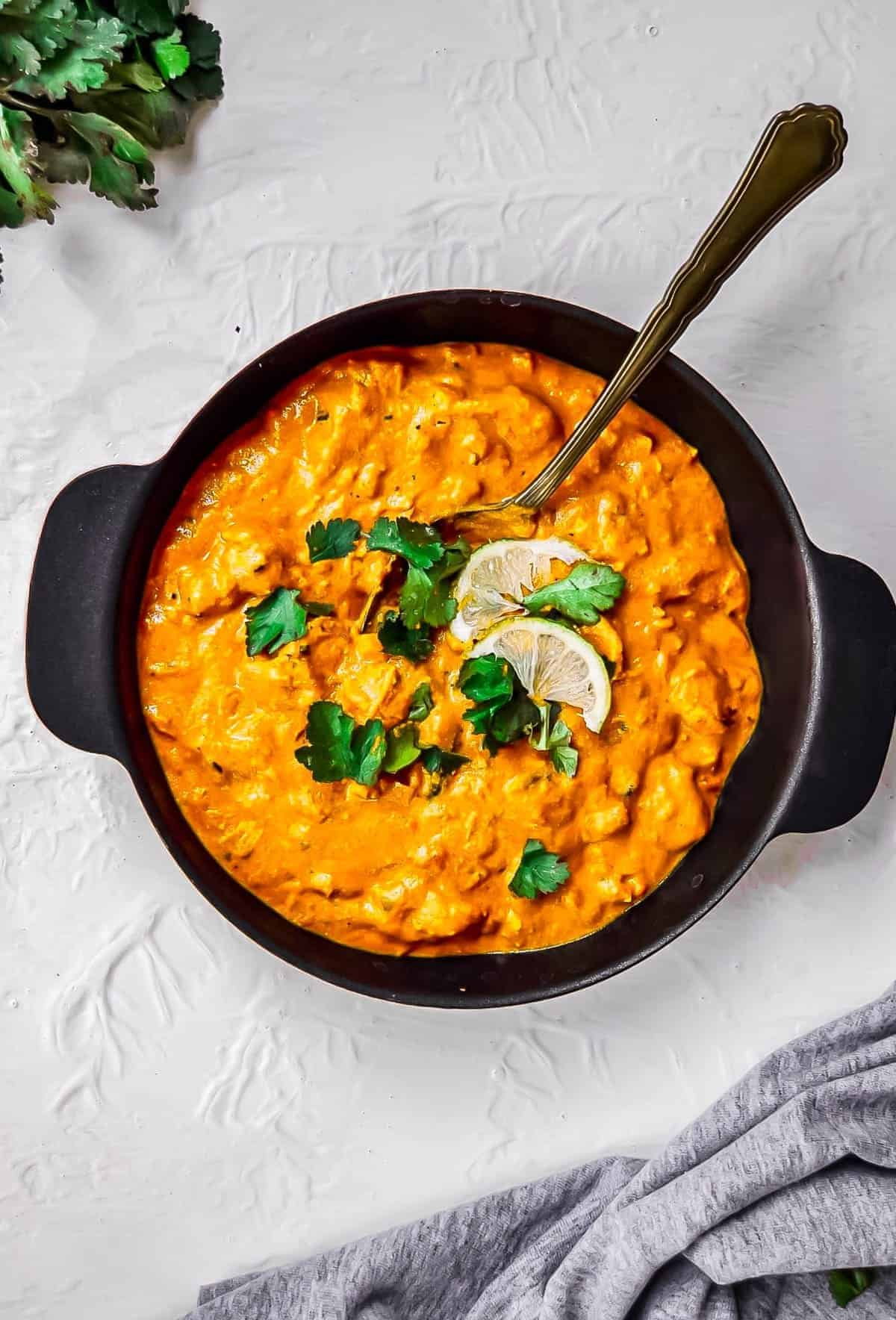 Chicken tikka masala in a bowl with cilantro