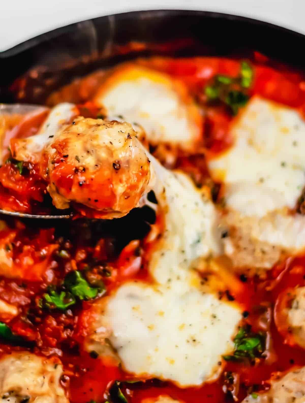Italian Baked Chicken Meatballs are my favorite easy and amazing Chicken Meatballs Recipe. This recipe for Spicy Italian Chicken Meatballs brings you straight to Italy with soft meatballs, rich sauce, and ooey-gooey cheese.