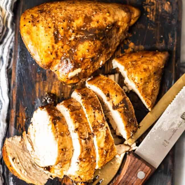 baked lemon pepper chicken on cutting board