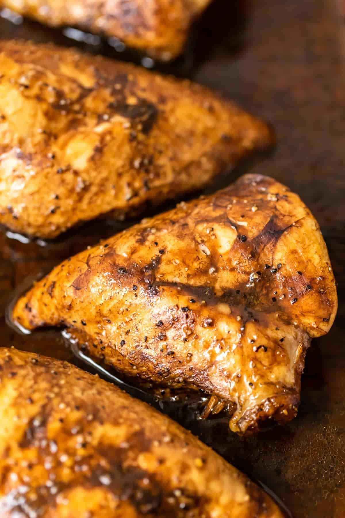 Marinated Baked Lemon Pepper Chicken up close in marinade