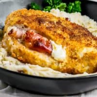Prosciutto and Cheese Stuffed Chicken Breast is the perfect Easy Chicken Recipe for impressing guests! They sound fancy and gourmet, but if you can bake a chicken breast you've got this one in the bag. This Prosciutto and Cheese Stuffed Chicken Breast Recipe was born out of a dream to stuff a cheese board into a chicken breast! The flavors of Burrata cheese (the queen of all cheeses), salty prosciutto, and tender chicken, makes this an winning recipe.