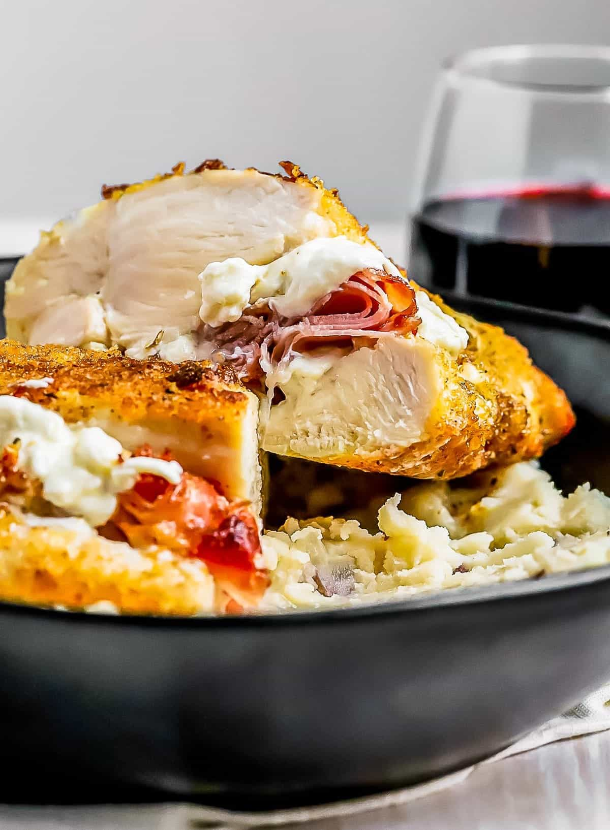 Cut shot of Prosciutto and Cheese Stuffed Chicken Breast tender juicy stuffed chicken