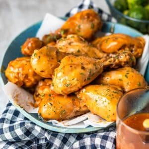 Slow Cooker BBQ Chicken Drumsticks feature an easy Homemade BBQ Sauce that is to die for! Everything cooks together in the crock pot and at the end of the day you're ready to eat! This is our go-to easy family meal when we are craving homemade bbq chicken.