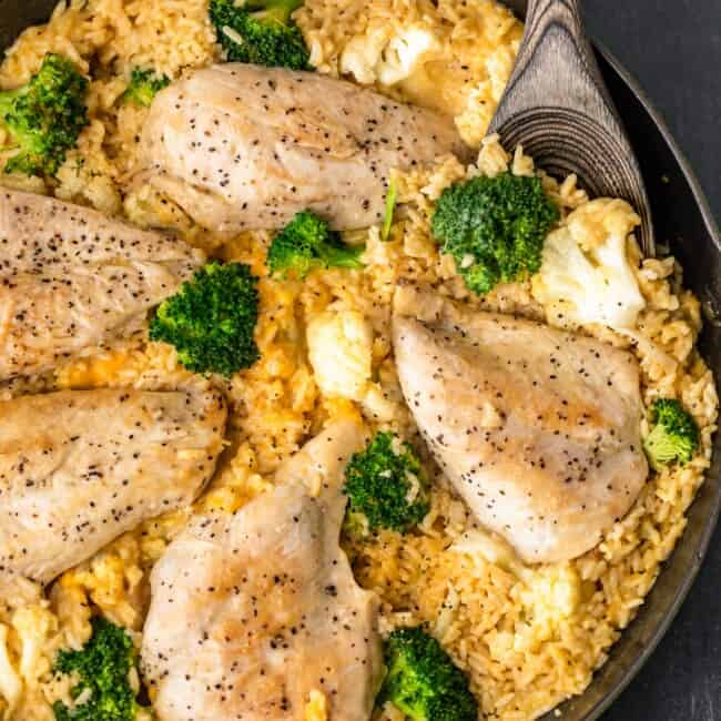 One Pot Cheesy Chicken and Rice is our GO TO simple weeknight meal the entire family loves. Cheesy Chicken and Broccoli is comfort food with none of the fuss. Creamy, easy, quick, and delicious!