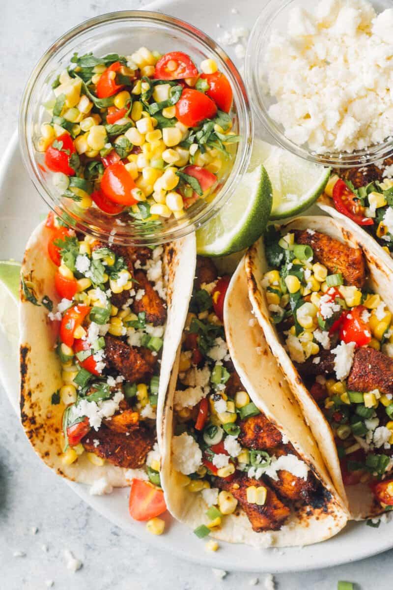 corn salsa next to chicken tacos