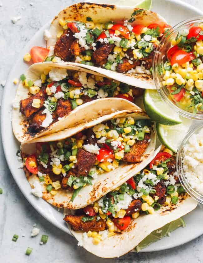 marinated chicken tacos on plate with corn salsa