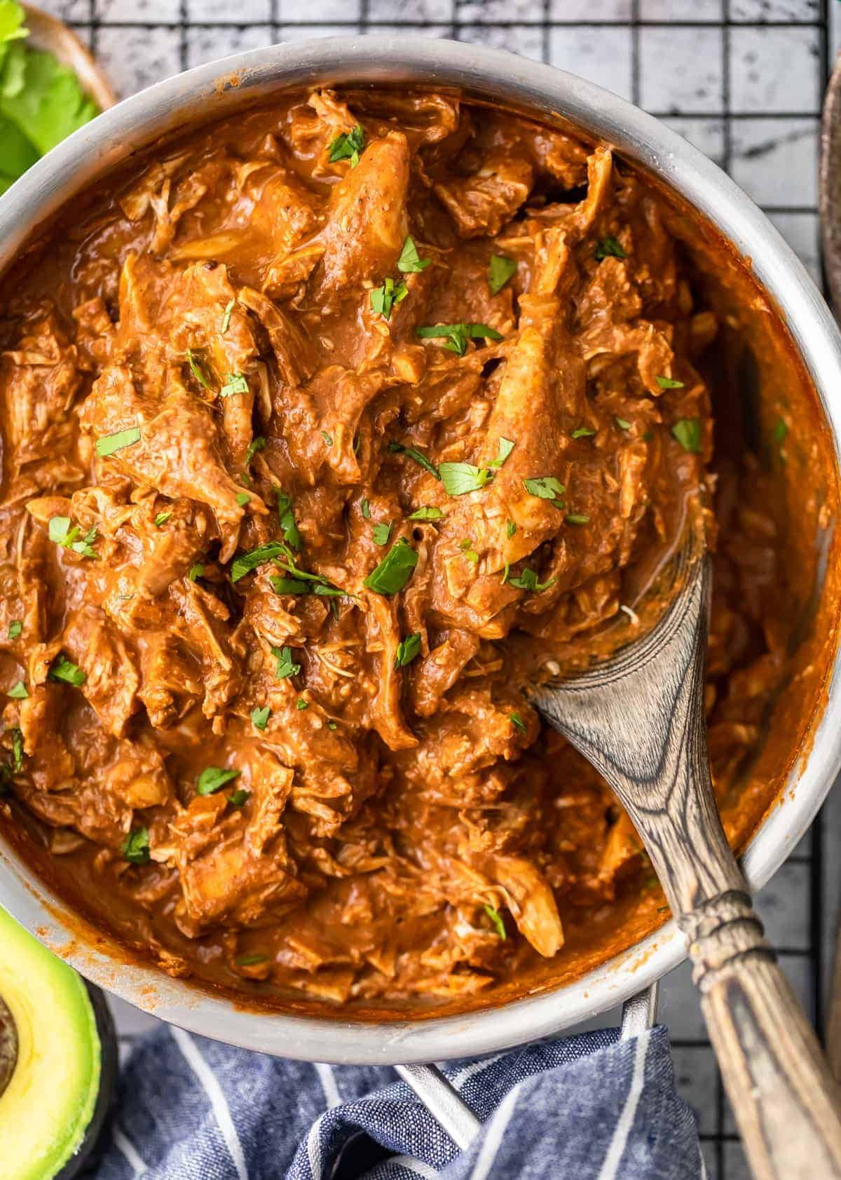 up close picture of mole sauce over chicken in a saucepan