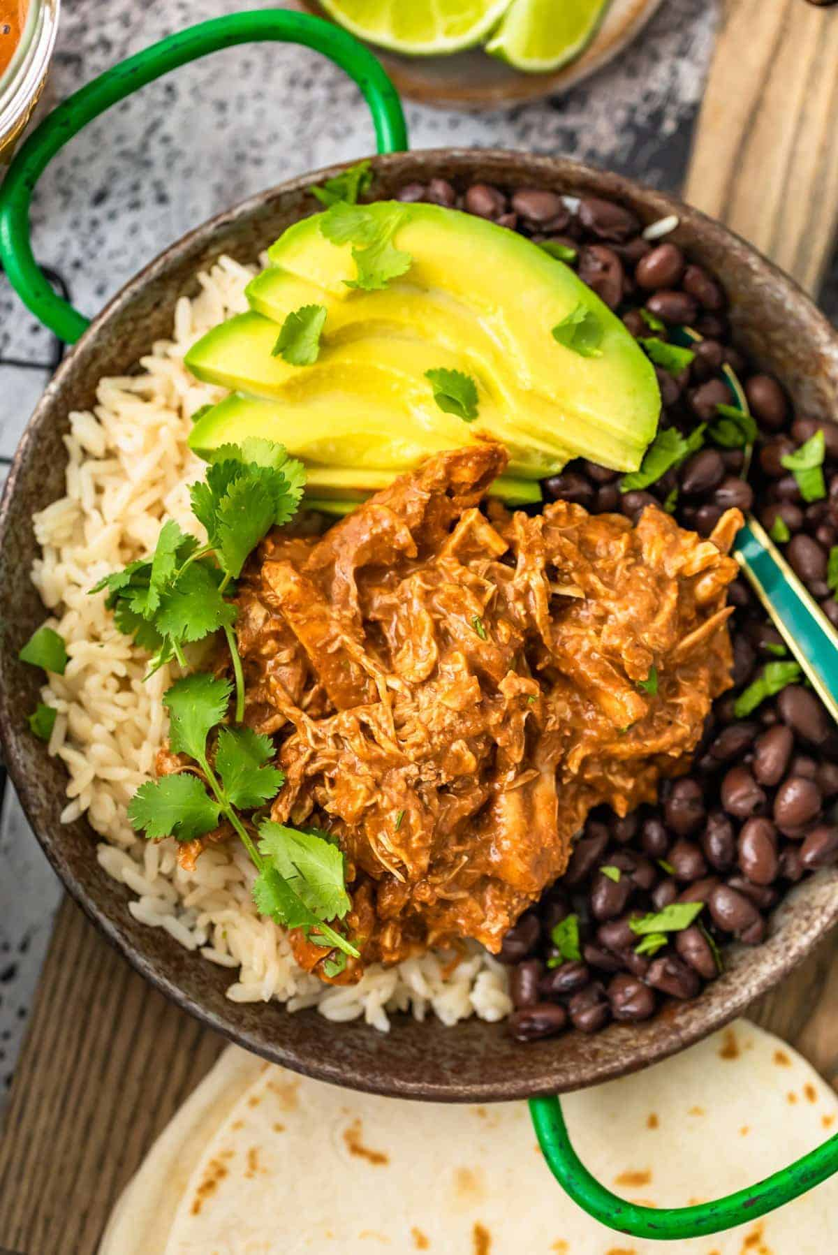 chicken mole over rice with black beans and avocado