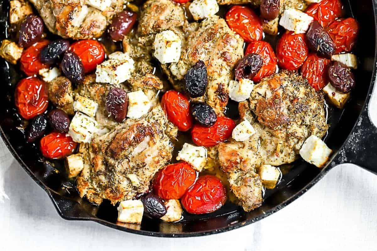 Top down shot of Greek Chicken being cooked in a skillet