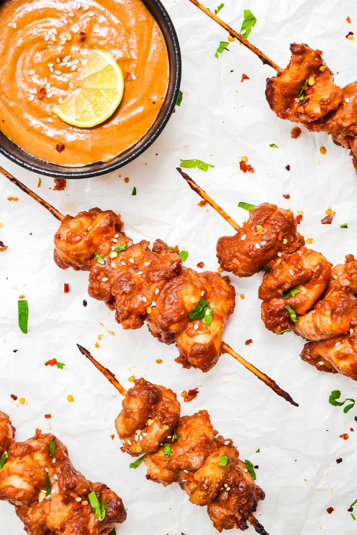 overhead chicken satay skewers with peanut sauce