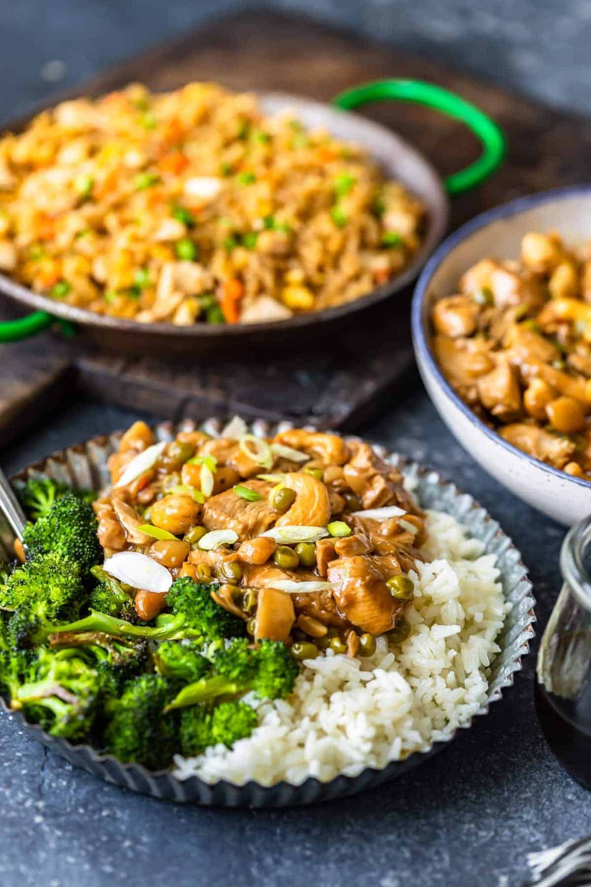 Rice, broccoli and Chinese chicken served on a metal plate
