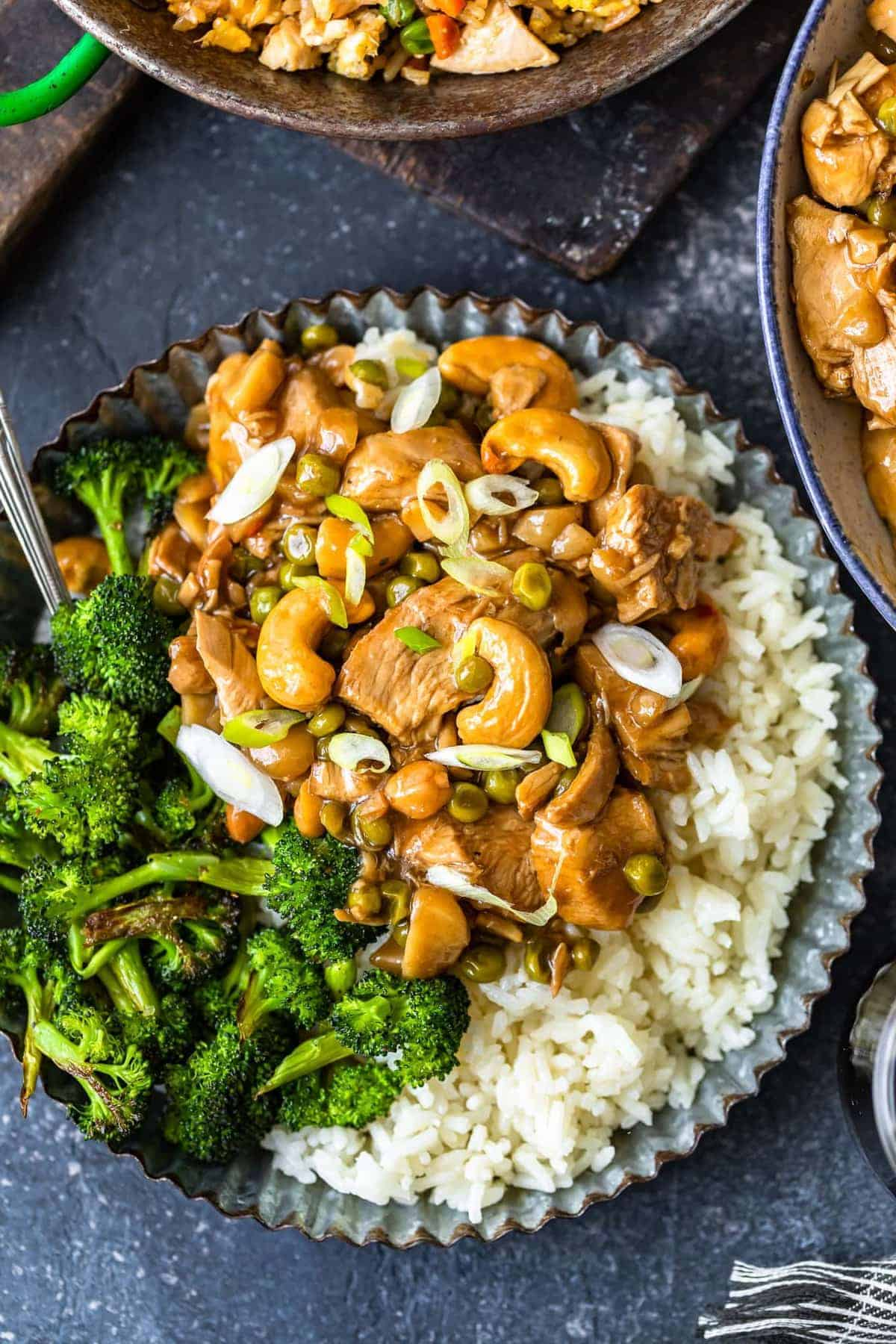 Homemade cashew chicken served with rice and broccoli