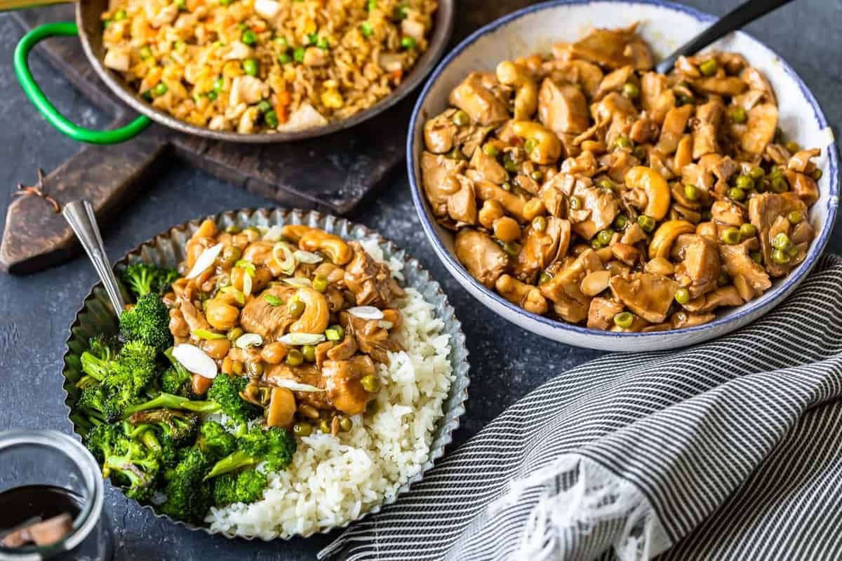 Homemade cashew chicken in a wok, bowl, and served on a plate with rice