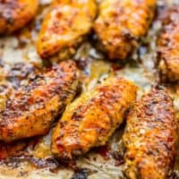 up close picture of baked chicken wings on sheet pan