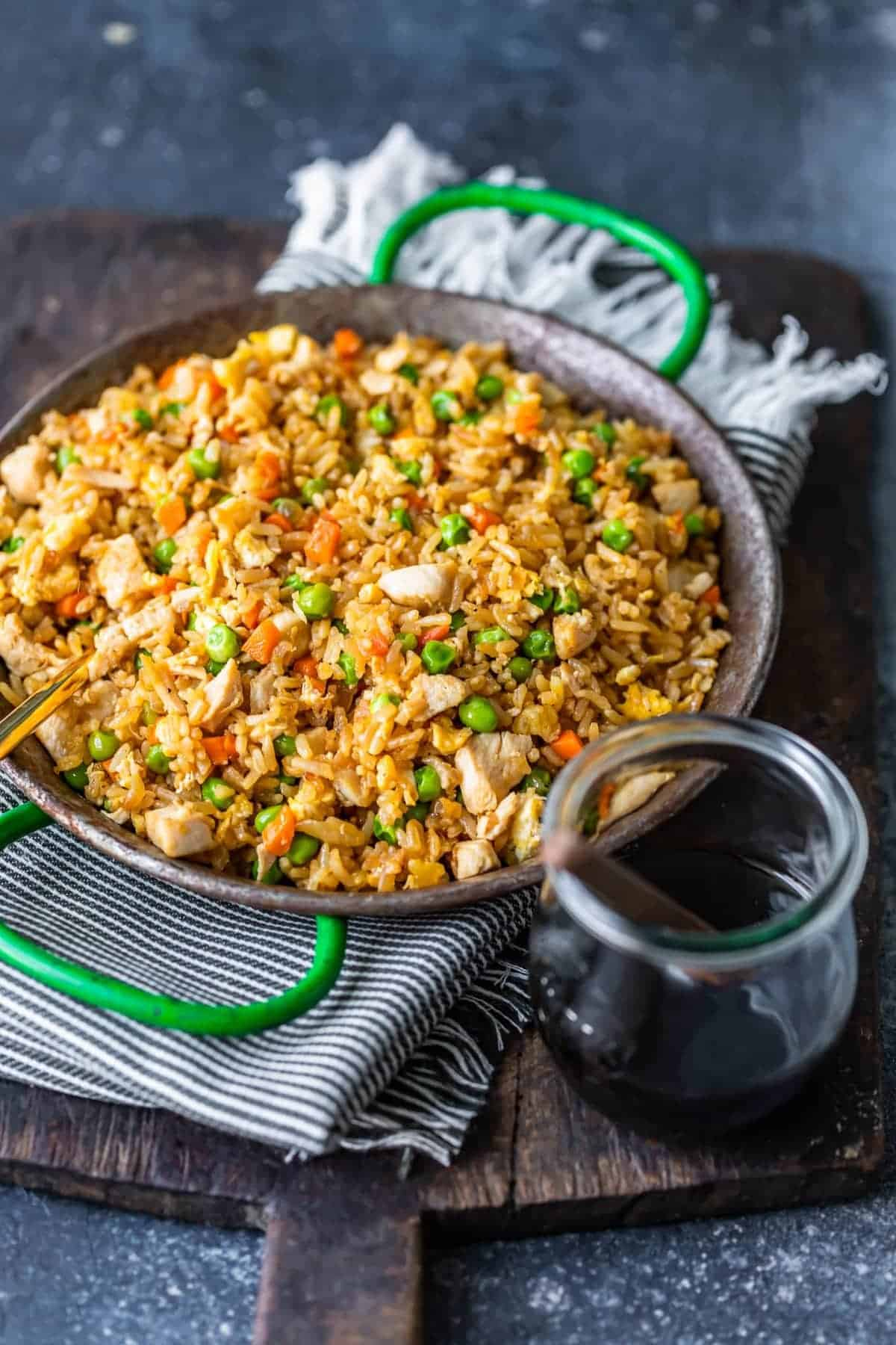 chicken fried rice in a dish next to soy sauce