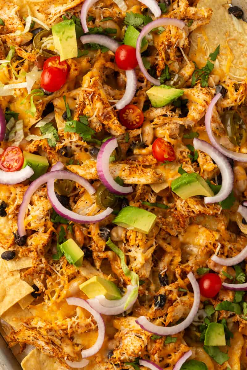 shredded chicken nachos on sheet pan
