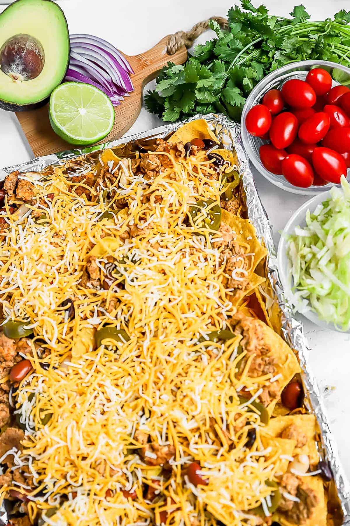 Nachos on a sheet pan before being cooked