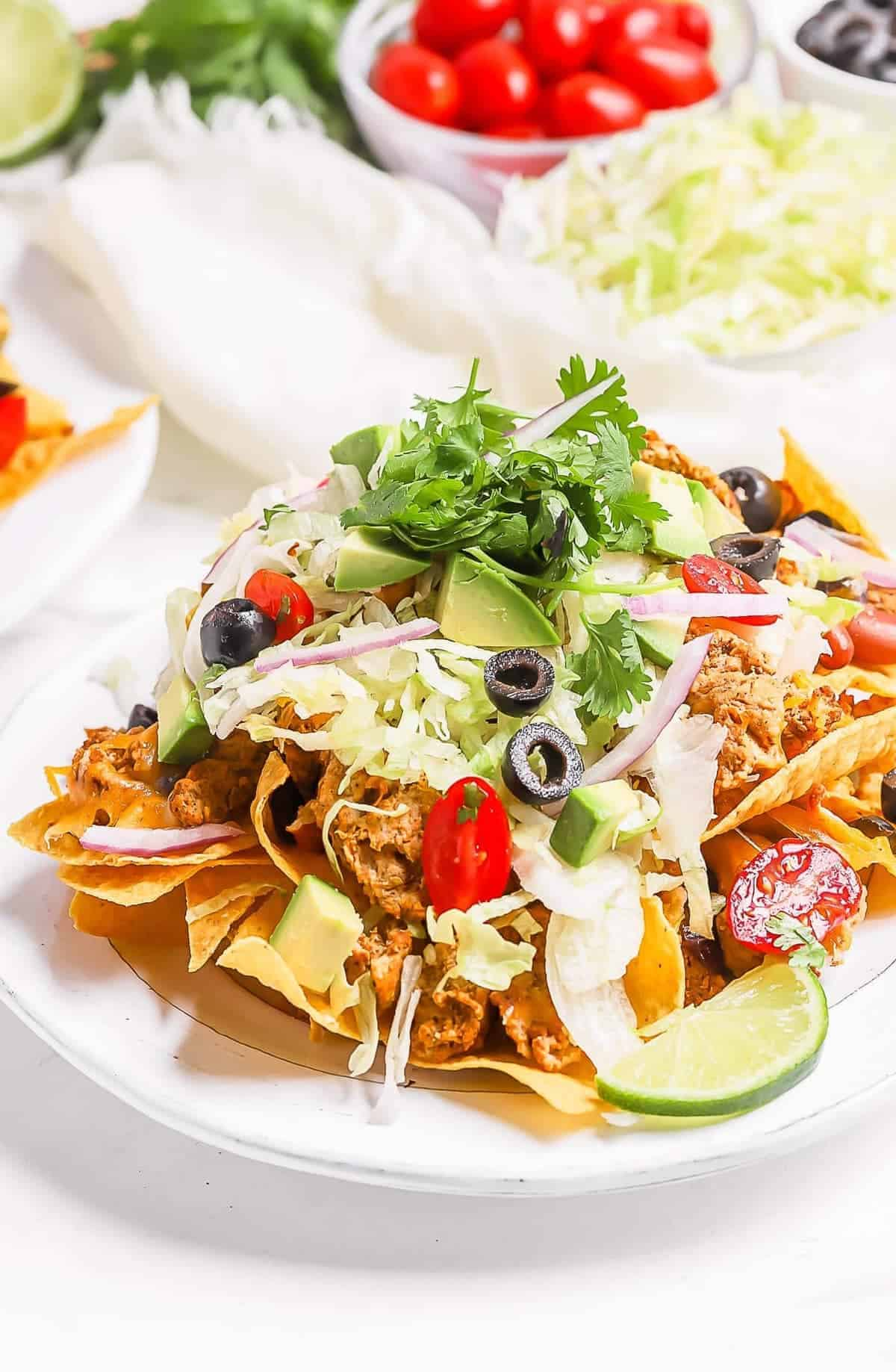 chicken nachos topped with fresh salad
