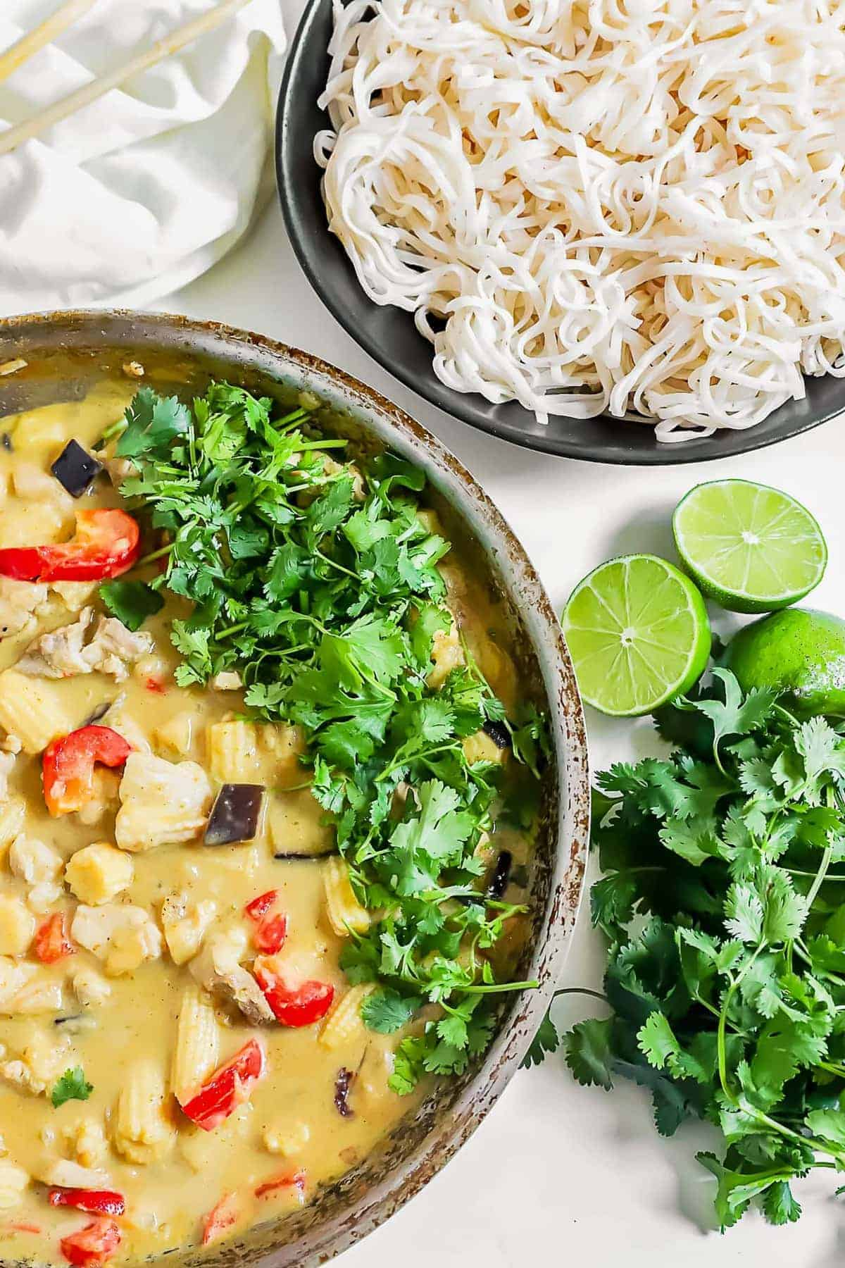 Thai green curry next to a bowl of noodles