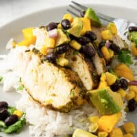 sliced chicken breast with mango avocado salsa