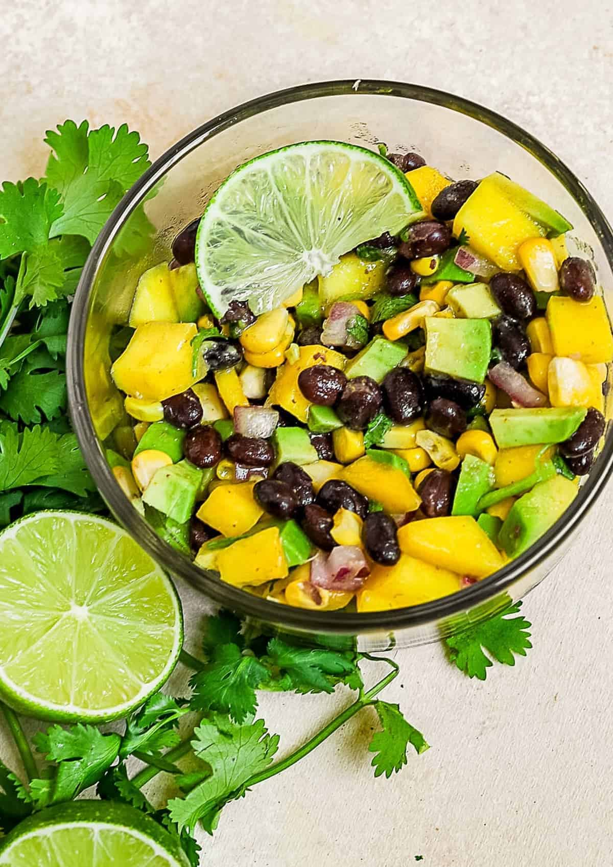 Avocado and mango salsa in a glass bowl