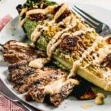 grilled chicken caesar salad on plate