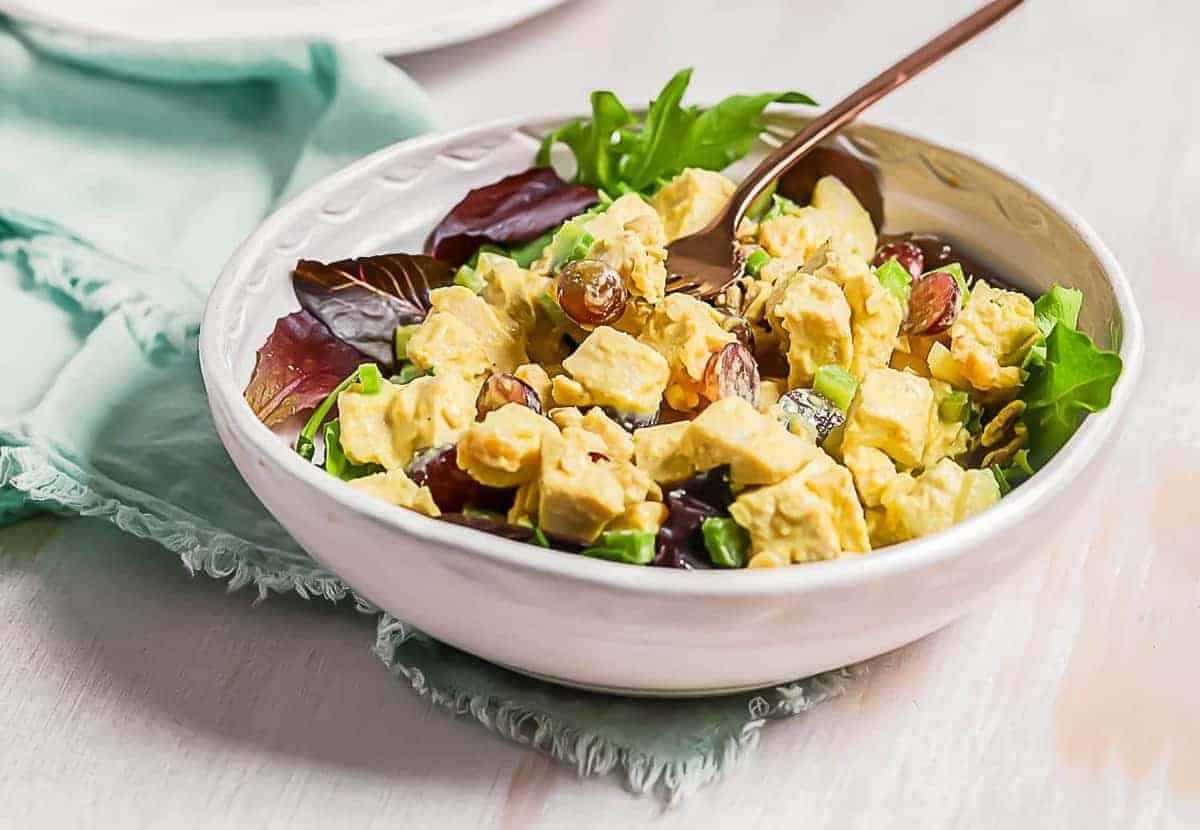 Honey mustard chicken salad served in a white bowl