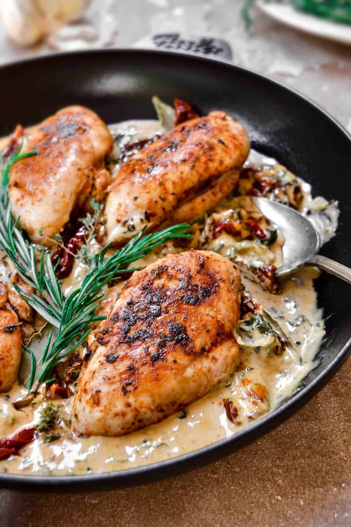 Chicken breasts in cream in a skillet