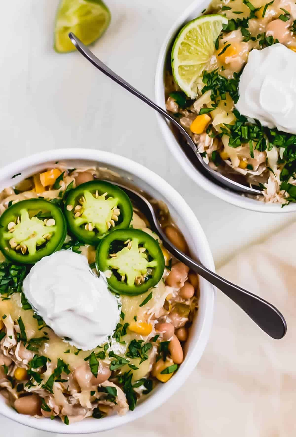 Slow cooker white chicken chili in two white bowls
