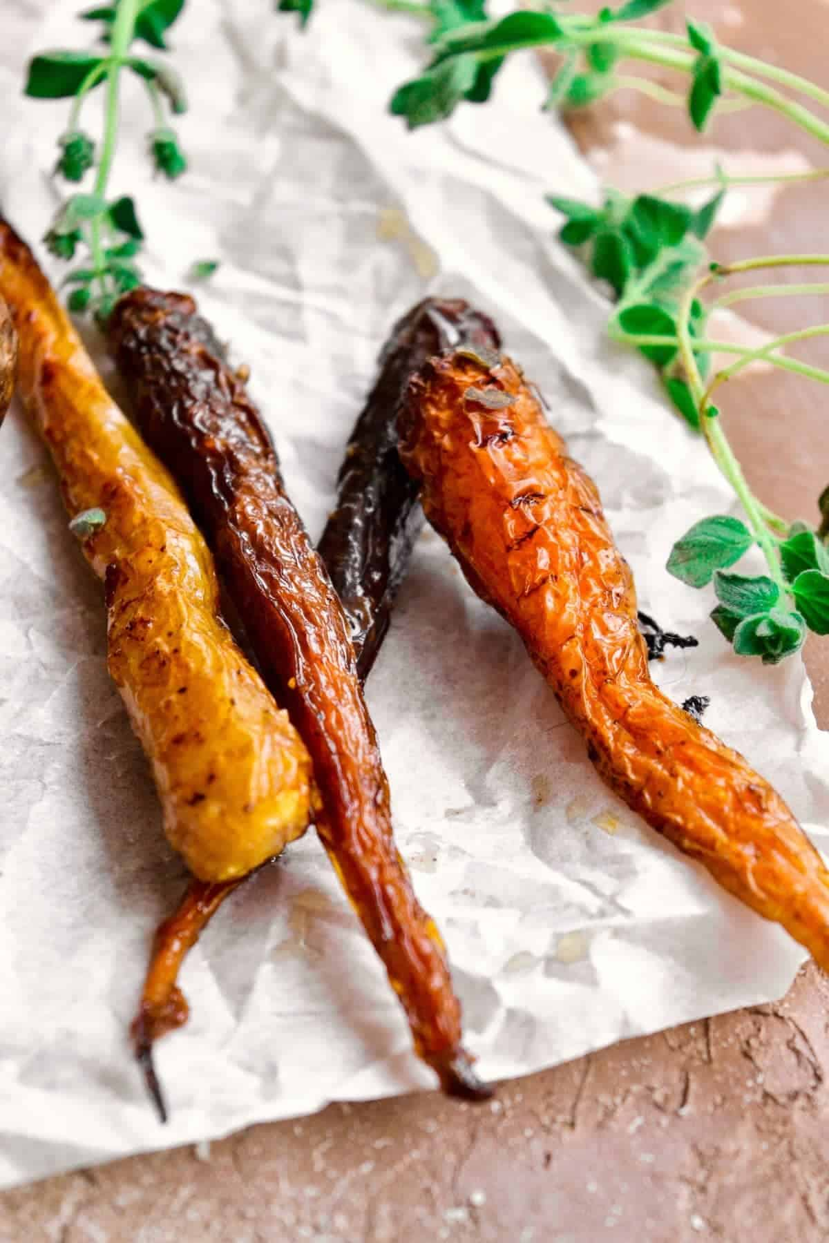 Baked carrots on parchment paper