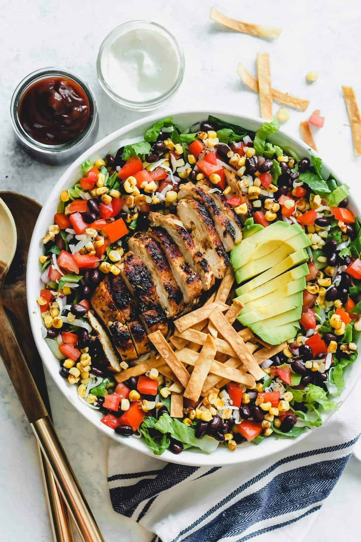 BBQ Chicken Salad served in a large bowl with sauces on the side