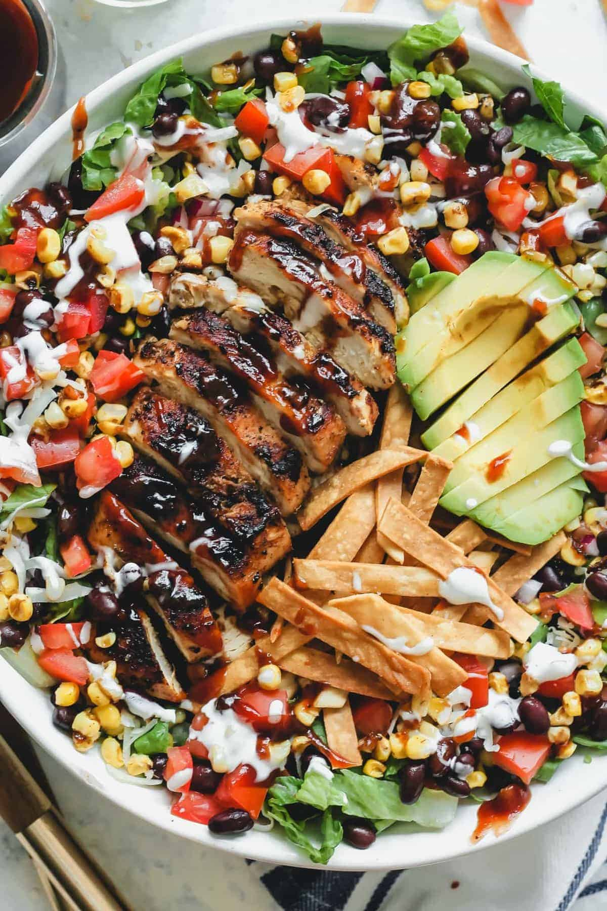 BBQ Chicken Salad in a large white bowl ready to serve