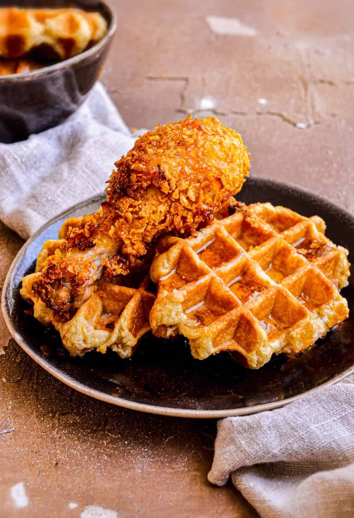 Chicken and Waffles on a black plate