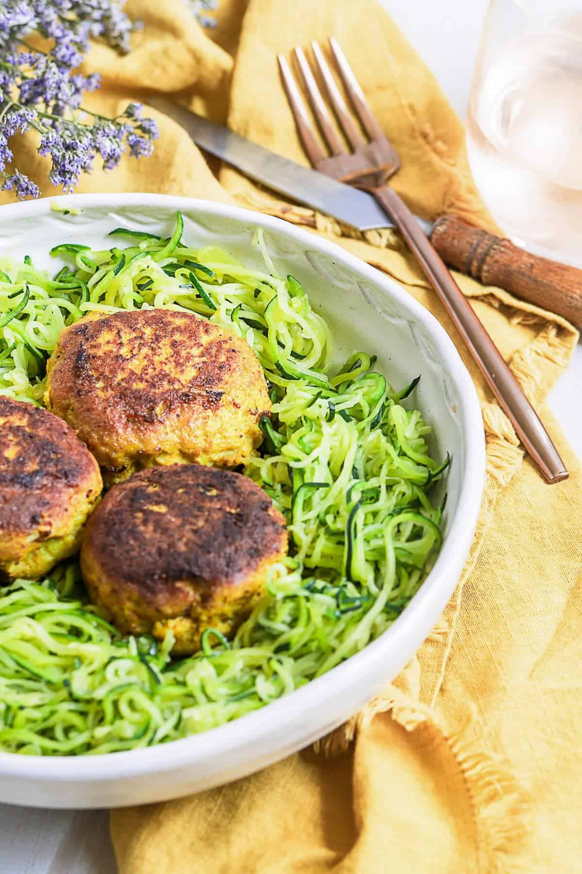 Meatballs and zoodles served with a knife and fork
