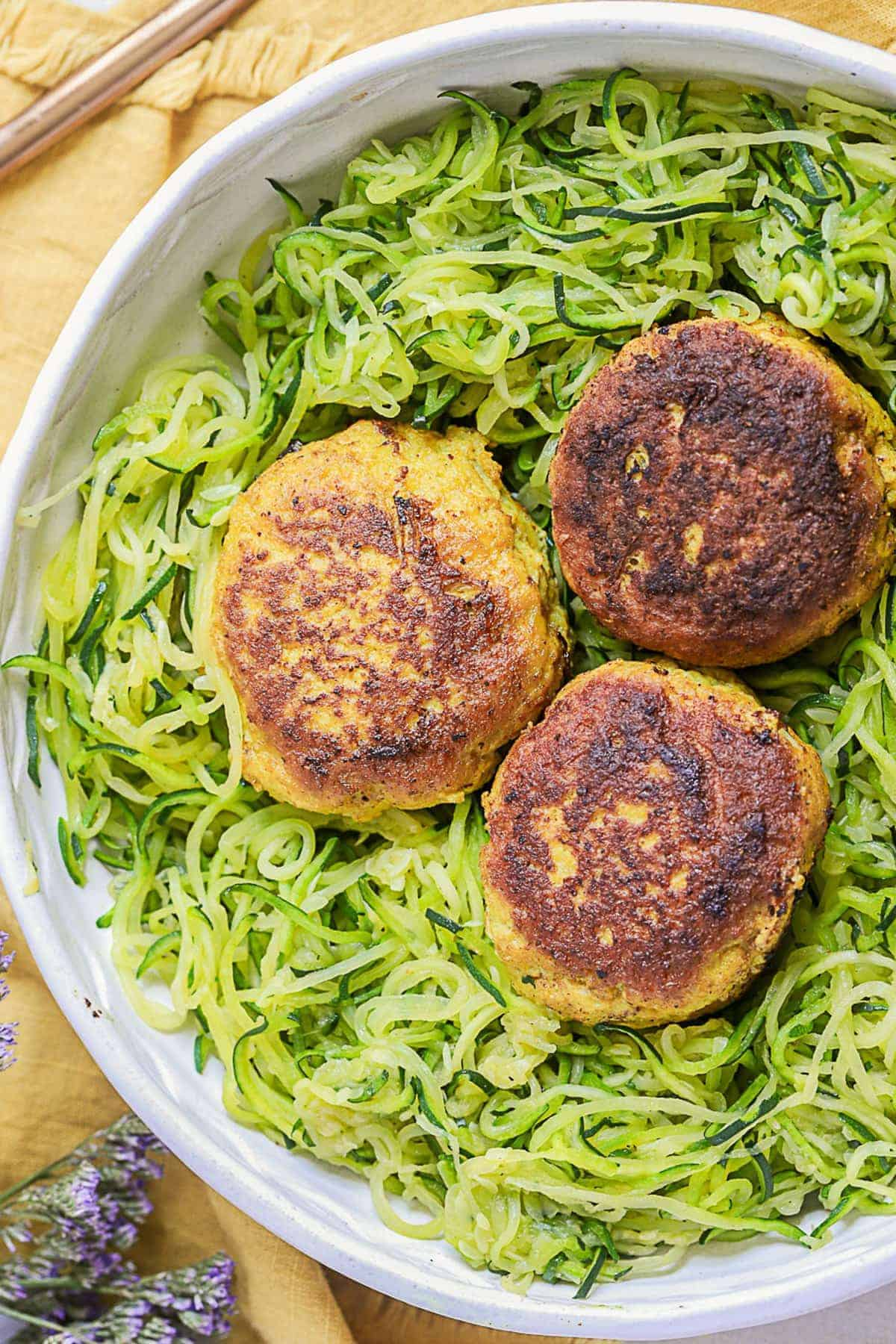 Three curry chicken meatballs on zoodles