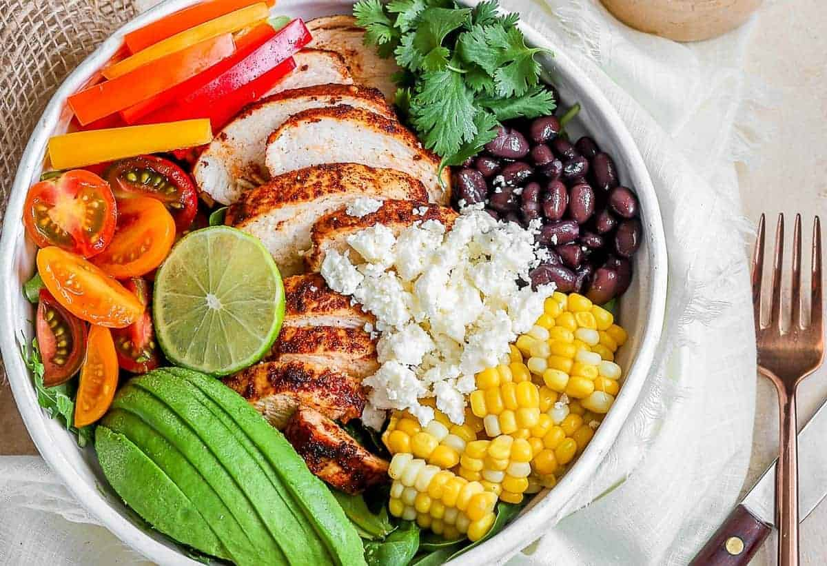 A Southwest Chicken Salad bowl with fresh vegetables