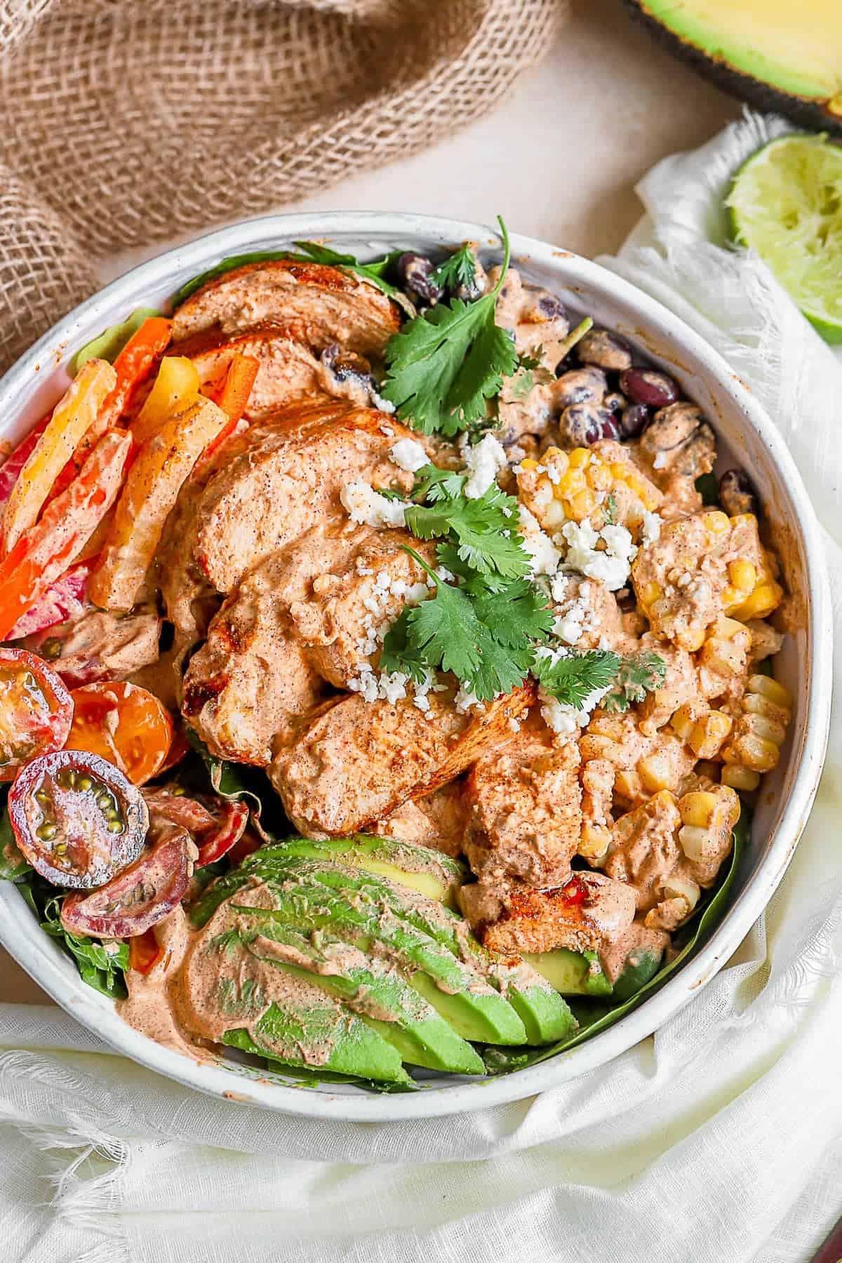 A finished Southwest Chicken Salad bowl with fresh garnish