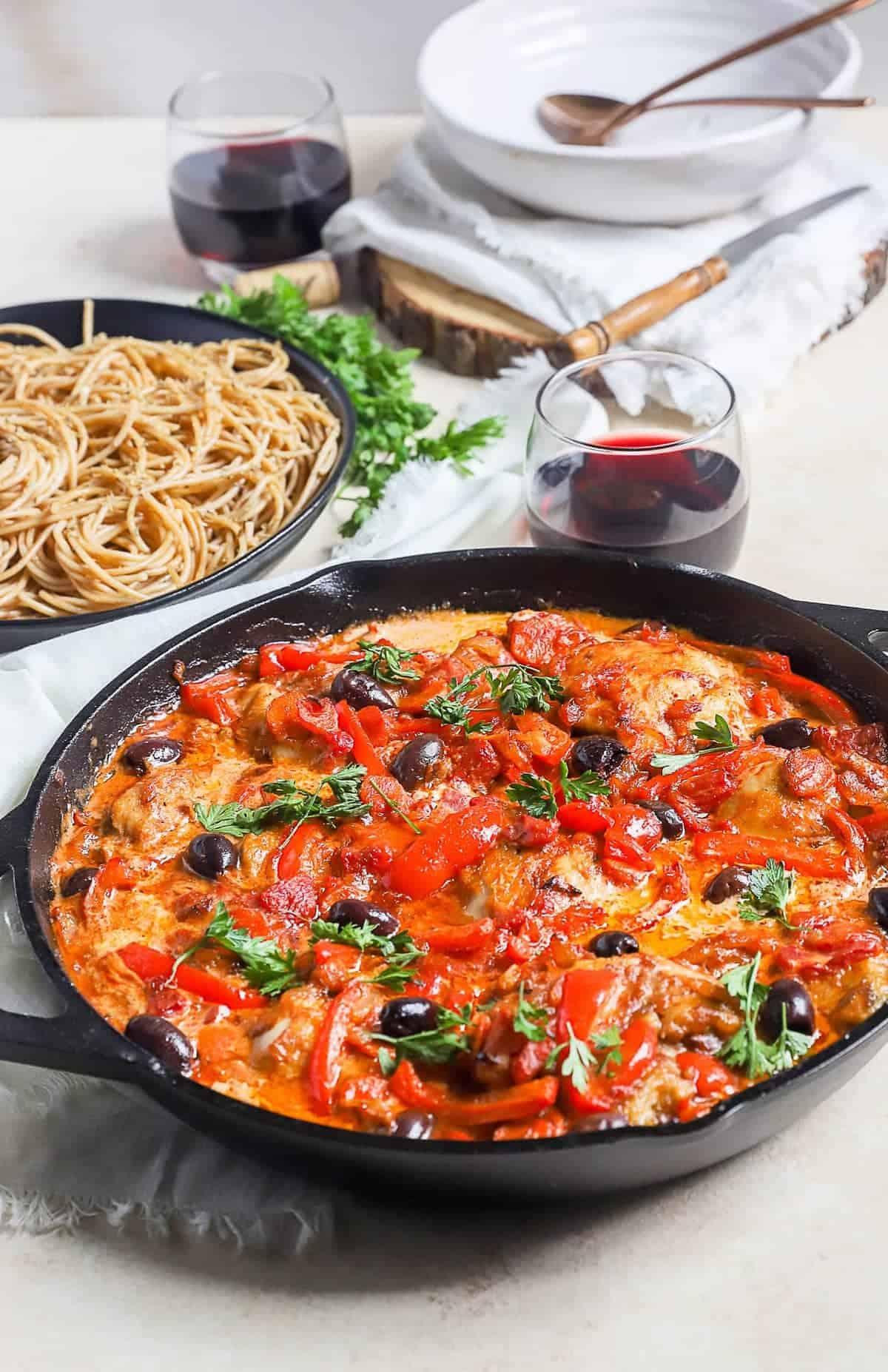 Chicken Cacciatore garnished with fresh herbs