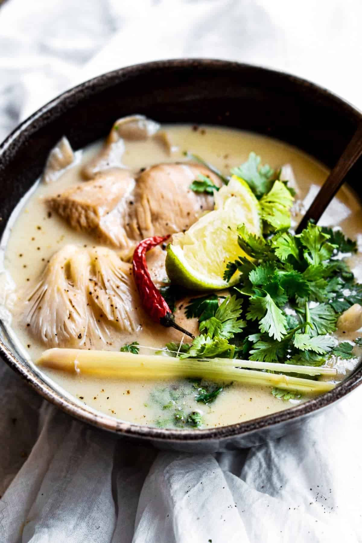 Chicken Coconut Soup in a black bowl