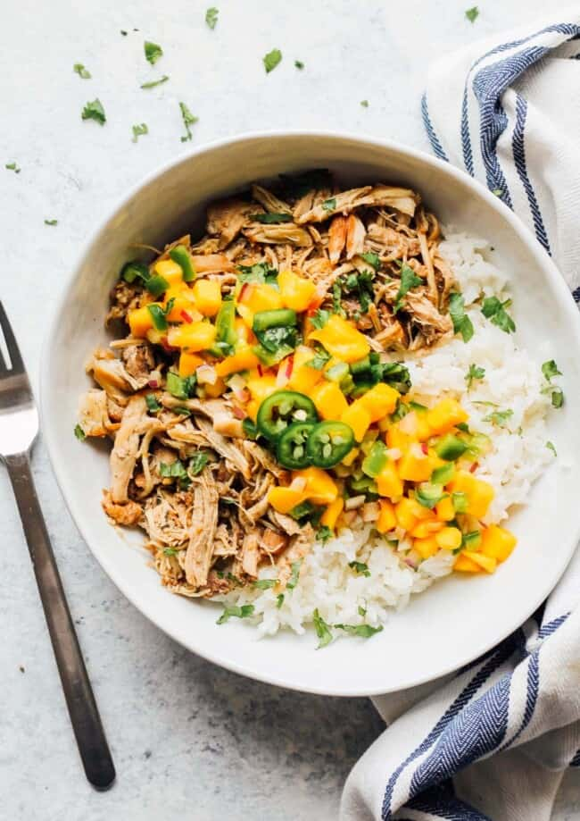 instant pot jerk chicken with mango salsa in bowl