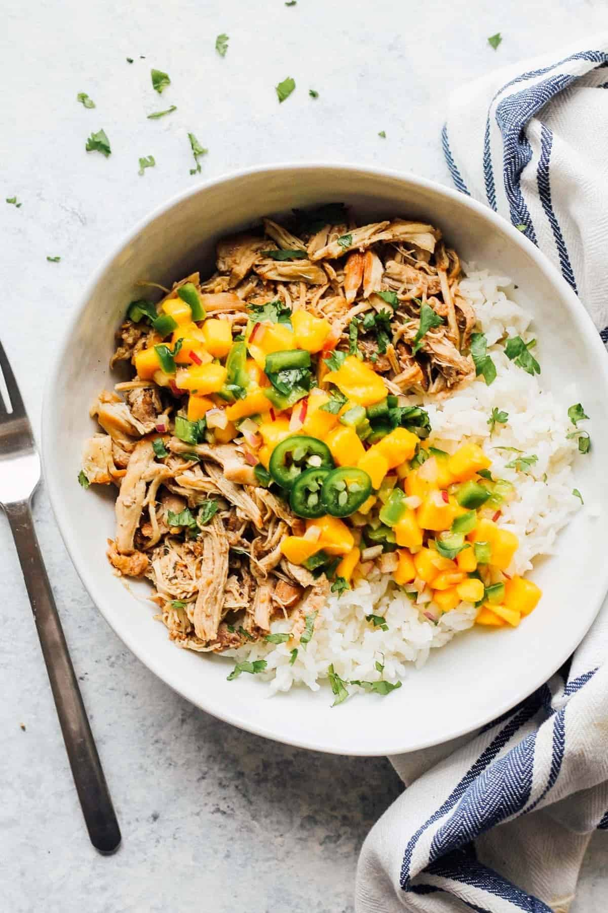 Instant pot jerk chicken served with rice in a white bowl